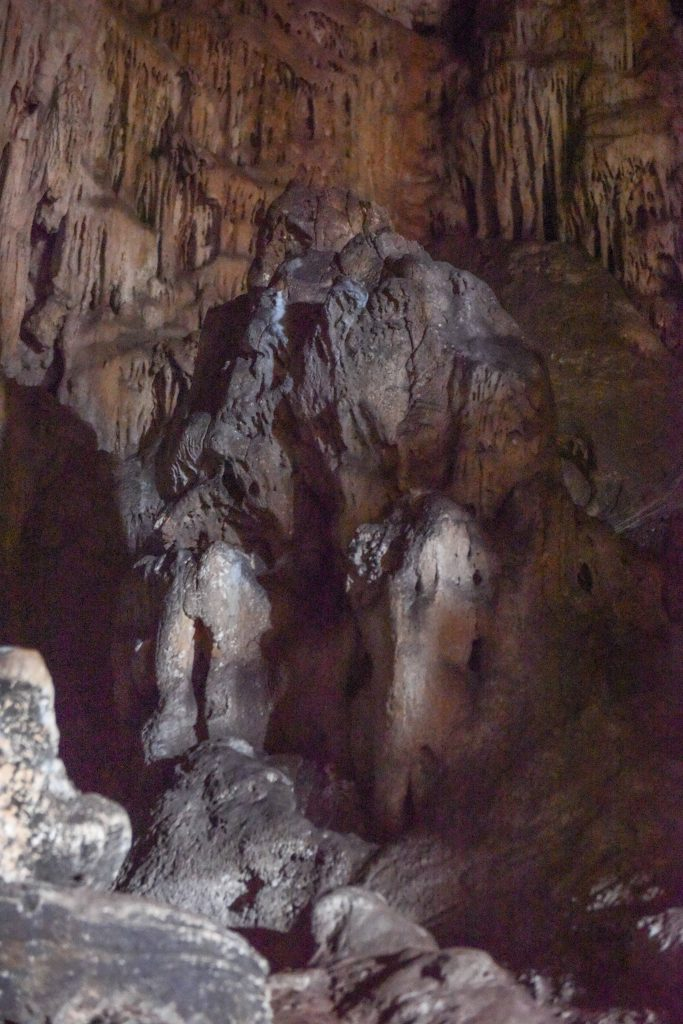 The stalagmite statue that looks like a thinking man.
